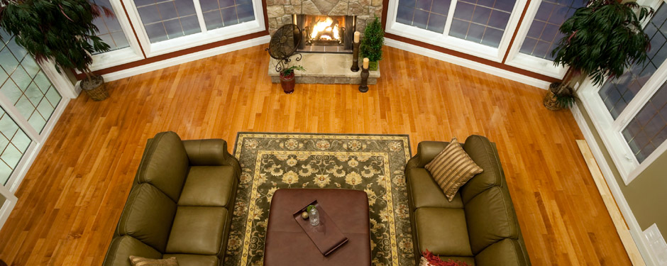 Aerial view of living room with hardwood floors