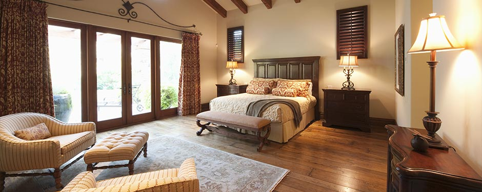 western bedroom with hardwood floors