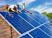 Contractor installing solar panels to green roof