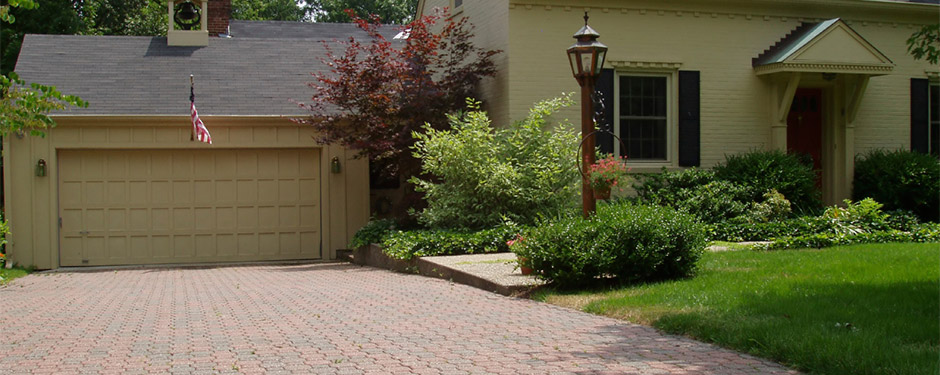 Driveway in front of Colonial house with pavers