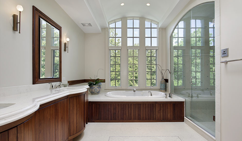 white bathroom with wood paneling
