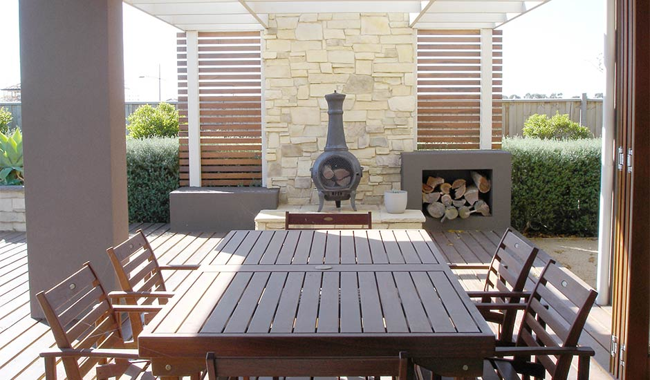 antique fireplace in backyard patio