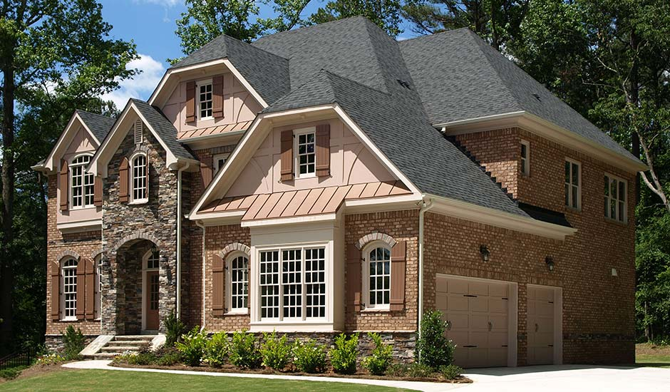 brick and stone luxury home with new roof