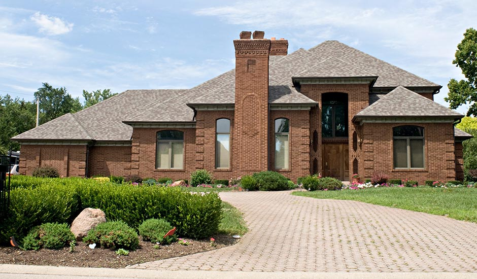 brick luxury home with new roof