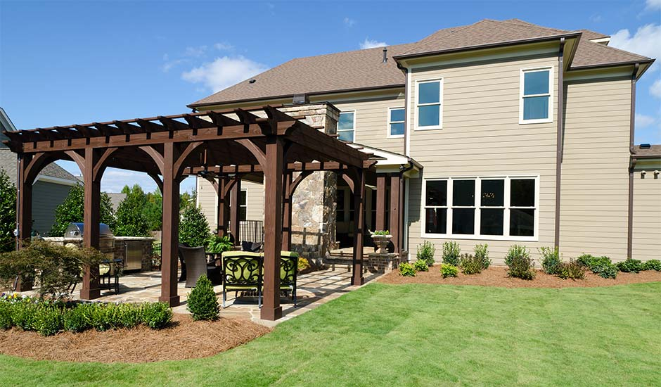 large backyard with patio awning