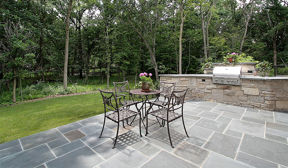 patio with custom BBQ and granite tiles