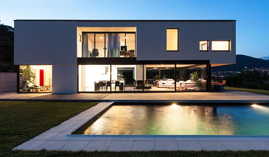 modern home and pool at dusk