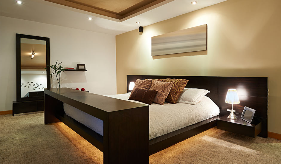modern lighting and painted bedroom