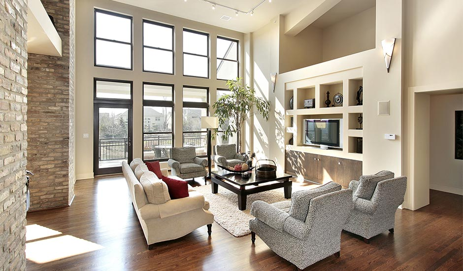 tall modern living room with large windows