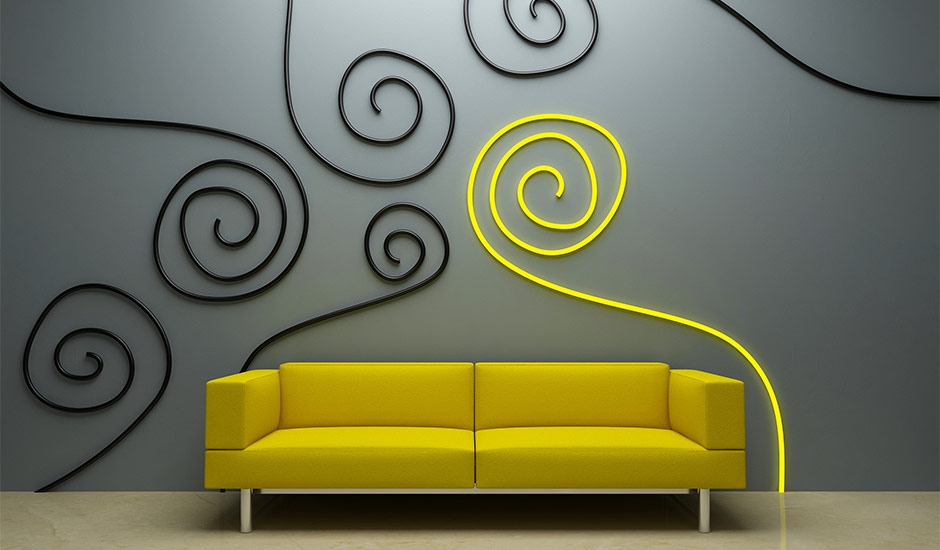 yellow couch and spiral wall art on grey wall