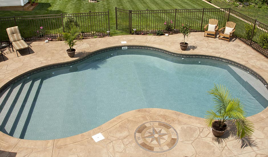 aerial view of backyard pool with decorative marble