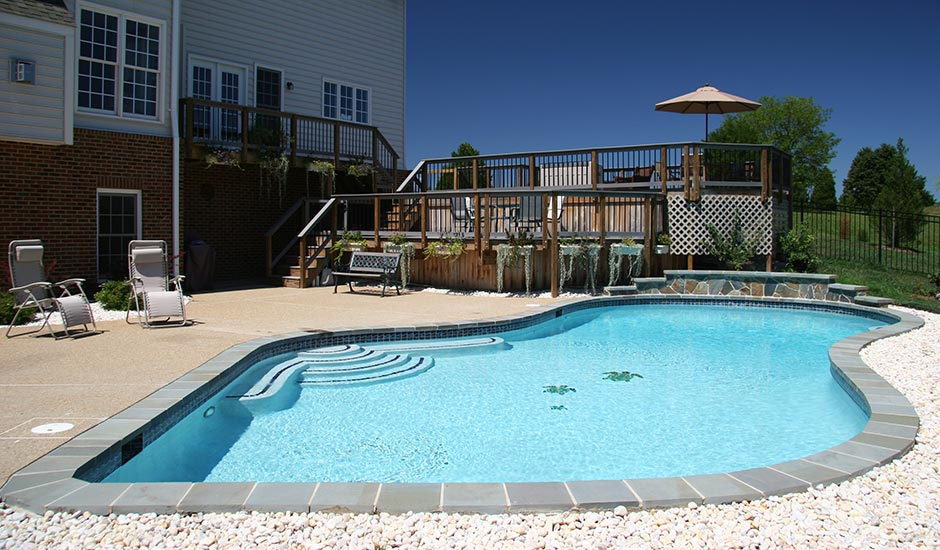backyard turtle pool with large deck patio