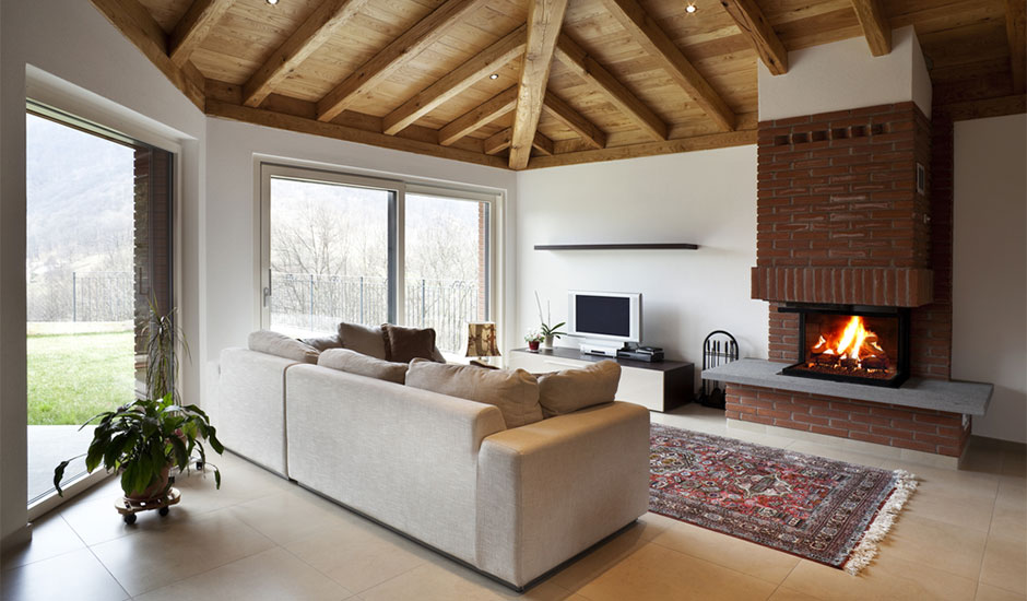 living room with fireplace and lofted ceilings