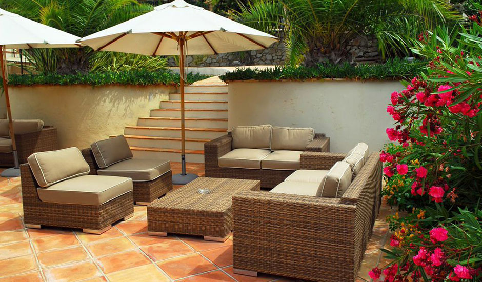 tiled patio with backyard furniture