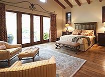 western bedroom with hardwood floors