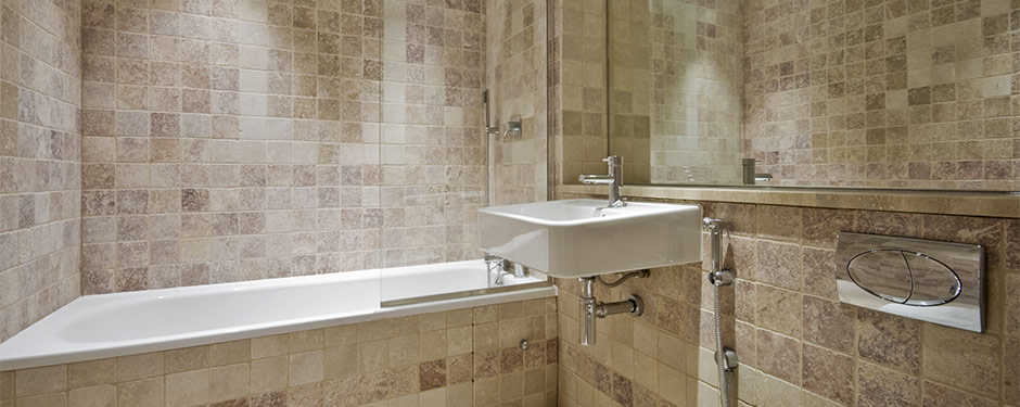 Modern bathroom with tan-colored tiles