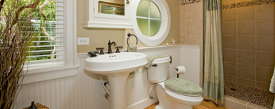 Small modern bathroom with porthole window