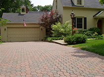 Garage with paver driveway