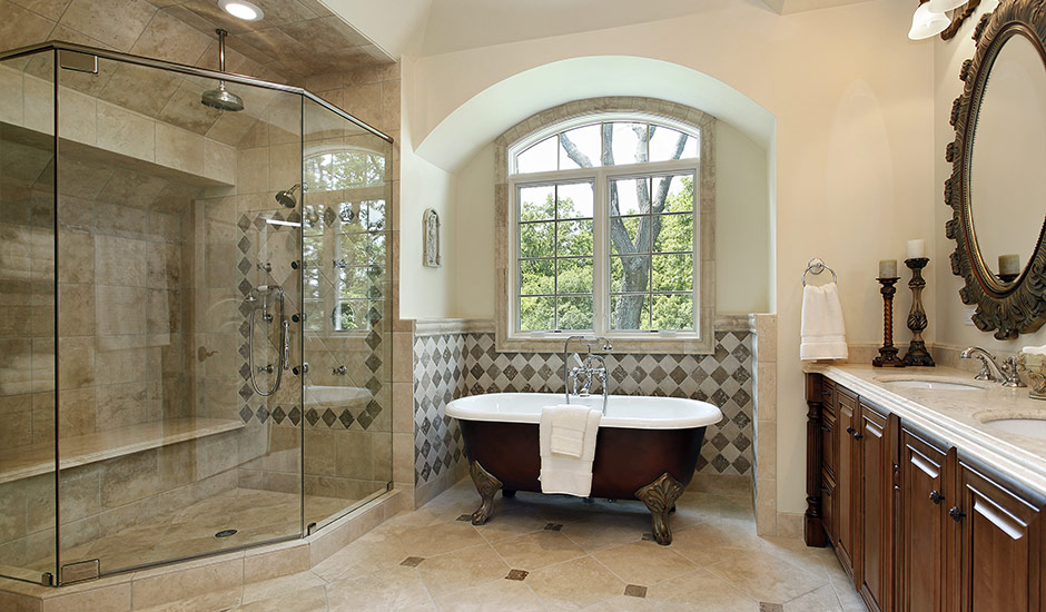 luxury bathroom with classic tub and walk-in shower