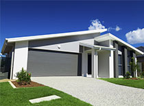 sloping roof and gravel driveway