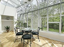 patio with large greenhouse windows
