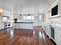 Contemporary kitchen with reclaimed hardwood floors